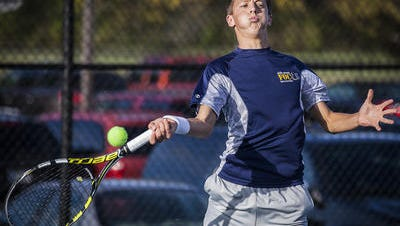 Delta's Alec Robillard competes in the Delta Sectional in 2015. The Eagles are looking to win their 24th straight boys tennis sectional title.