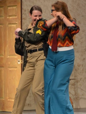 Officer Clanton, played by Juliana Johnson, reunites with old school friend Norma Corwin, played by Alyssa Facione at the Inn of the Three Sisters.