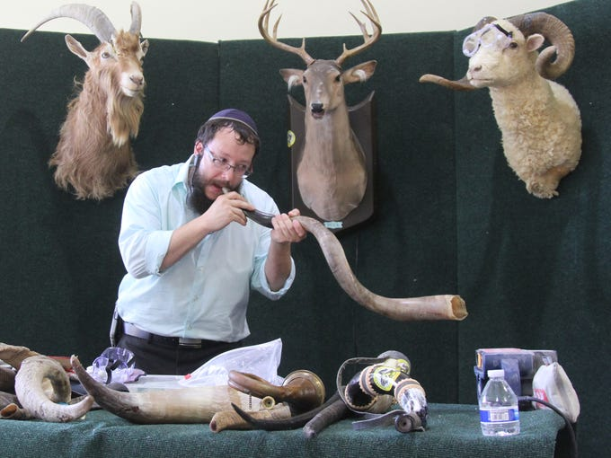 Rabbi Schmuly G., of Boca Raton, demonstrates how to