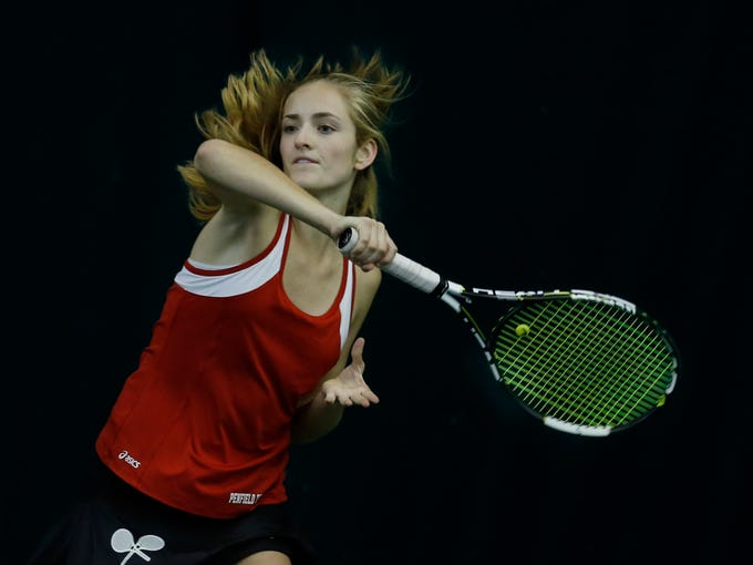 Penfield's Caitlin Hogan swings after a topspin forehand
