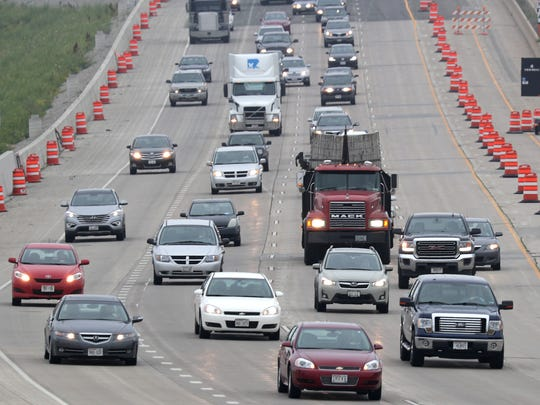 Traffic drives in a work zone Tuesday on Interstate 41 near the U.S. 10 and State 441 interchange in Fox Crossing.