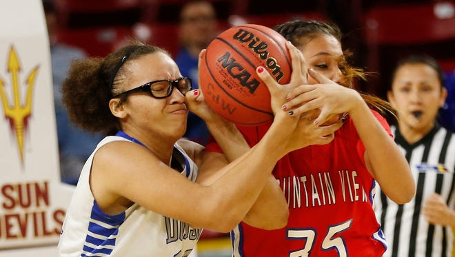 Dobson's Kayla Clark (left) and Mesa Mountain View's Shauna Bribiescas battle for a loose ball during the MLK Basketball Classic at Wells Fargo Arena on January 19, 2015.