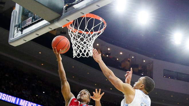 Mar 25, 2016; Philadelphia, PA, USA; Indiana Hoosiers guard Yogi Ferrell (11) shoots against North Carolina Tar Heels forward Brice Johnson (11) during the second half in a semifinal game in the East regional of the NCAA Tournament at Wells Fargo Center. Mandatory Credit: Bob Donnan-USA TODAY Sports