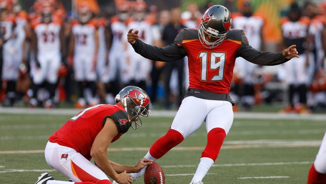 Tampa Bay Buccaneers kicker Roberto Aguayo (19) kicks a field goal against the Cincinnati Bengals during the first quarter at Paul Brown Stadium.