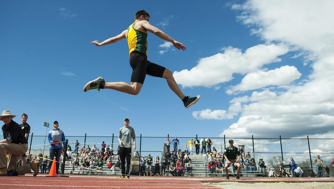 University of Vermont's Ian Weider leaps in his final attempt in the long jump competition during the America East outdoor track and field championships at the Frank H. Livak Facility on Saturday. Weider won the event with a personal best of 24 feet, 8.25 inches.