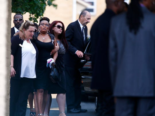 Family members are helped into St. Ann's Church in Keansburg Monday, July 24, 2017, where AbbieGail Smith's funeral was held.
