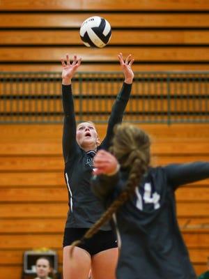 Mamie Garard sets to Rori Wood for the Zionsville High School volleyball team.