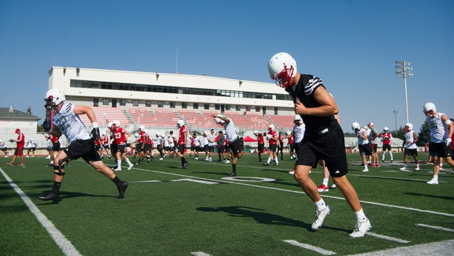 The SUU football team runs drills during practice at Eccles Coliseum Friday, August 3, 2018.