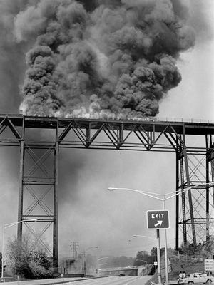 The Poughkeepsie Railroad Bridge, as seen from Route 9 in Poughkeepsie, burns out of control on May 8, 1974. Officials believe that sparks from train brakes may have been the cause of the blaze.