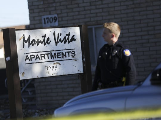 Police monitor the area around the Monte Vista apartment complex where an armed-robbery suspect fled after stealing a white pickup truck on March 6, 2018 in Phoenix. According to police the suspect's parents lived at the complex.