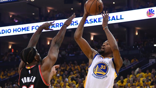 Golden State Warriors forward Kevin Durant (35) shoots the basketball against Portland Trail Blazers forward Noah Vonleh (21) during the first quarter in game one of the first round of the 2017 NBA Playoffs at Oracle Arena.