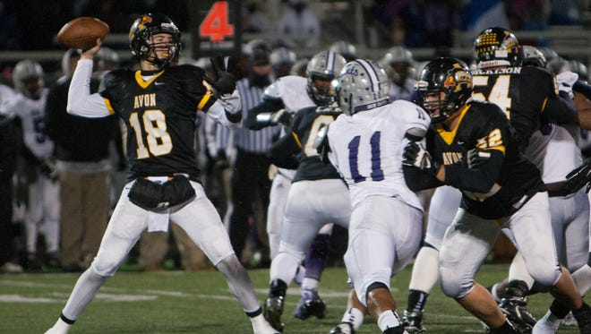 Avon quarterback Brandon Peters throws a pass against Ben Davis during sectional action at Avon, Oct. 31, 2014.
