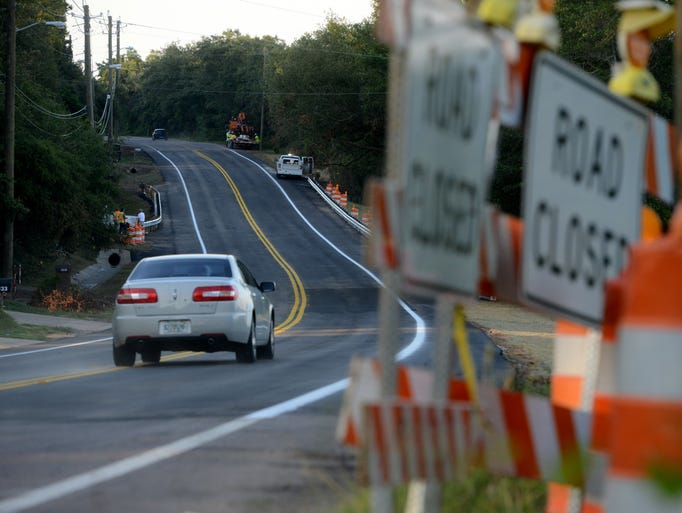 Scenic Highway is reopened to traffic Thursday more than two months after a large section north of Summit Boulevard was washed out during the flood in April.