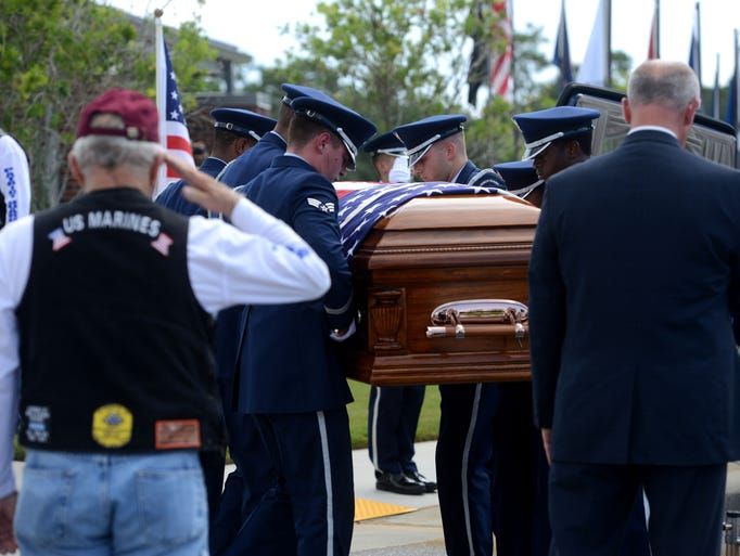 Members of an Air Force Honor Guard carry the casket of Timothy Wright while he is saluted Friday during a burial ceremony at Barrancas National Cemetery. Timothy Wright, an Air Force senior airman, was killed in a training accident July 17 at Pope Army Airfield in North Carolina. Wright, 30, was a 2003 graduate of Pensacola Christian Academy. He enlisted in the Air Force in 2009 and served two tours in Afghanistan as a medical worker.