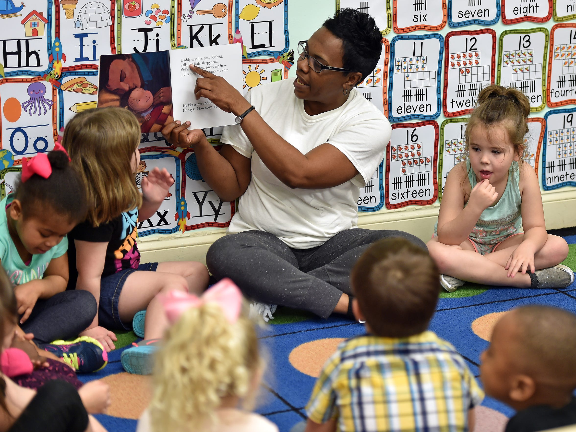 Teacher Gales Williams reads to her students Tuesday at Lake Village Learning Center in Flowood. The center is getting help from Mississippi Building Blocks, a state-funded program designed to assist licensed child care centers to improve the school readiness of children by improving teaching and learning.and strengthening parenting skills.