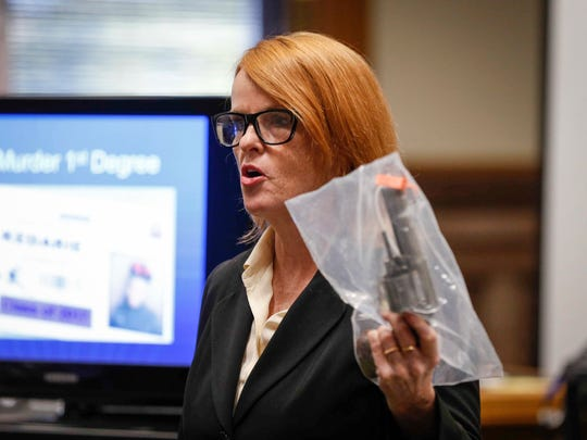 Iowa assistant attorney general Laura Roan holds up the murder weapon as she gives her closing remarks in the trial of Jorge Sanders-Galvez on Friday, Nov. 3, 2017, in Keokuk. Sanders-Galvez is accused of murder and in the death of Kedarie Johnson.