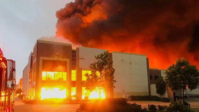 A warehouse fire in Redlands prompted a local air management district to issue a smoke advisory for parts of the Victor Valley on Friday, June 5, 2020.