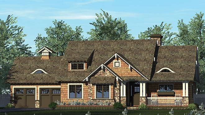 Rich details like double columns, stone accents, and a shed dormer create this seriously eye-catching exterior.