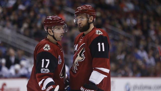 Coyotes' Radim Vrbata (17) and Martin Hanzal (11) talk during a timeout in the second period against the Canucks at Gila River Arena on January 26, 2017 in Glendale, Ariz.