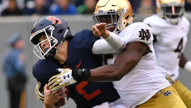 Oct 1, 2016; East Rutherford, NJ, USA; Syracuse Orange quarterback Eric Dungey (2) is tackled by Notre Dame Fighting Irish linebacker Nyles Morgan (5) in the second quarter at MetLife Stadium. Mandatory Credit: Matt Cashore-USA TODAY Sports