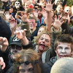 People take part in a Zombie Walk event in Kiev on October 31, 2015, to mark Halloween.
