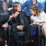 "From left, host Ryan Seacrest and judges Keith Urban and Jennifer Lopez speaks onstage during the ""American Idol"" panel discussion at the FOX portion of the 2015 Winter TCA Tour."