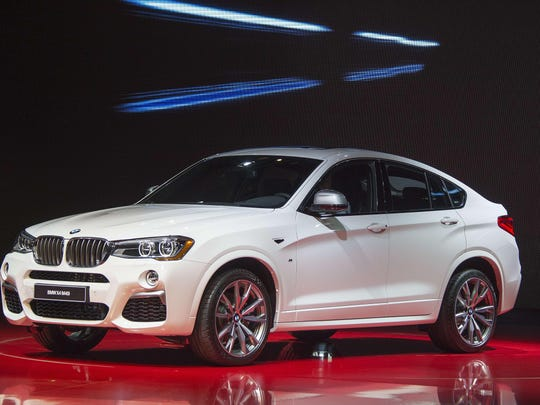 The 2016 BMW X4 M40i is unveiled at the North American International Auto Show in Detroit on Monday, Jan. 11, 2016.