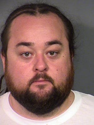 Russell was being held in a Las Vegas jail late Wednesday, following his arrest on weapon and multiple drug charges.