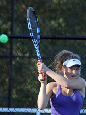 Anya Ivenitsky of John Jay Cross River returns a shot to Kiera Tobia of Ursuline during the Section 1 Girls' Tennis Singles Championship Tournament at Harrison High School Oct. 20, 2015.
