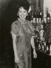 In this 1990 photo provided by Trader Vic's, Claudette Lum is seen at the flagship restaurant in San Francisco. After 57 years as a hostess and maitre d', Lum is retiring at the end of the year.