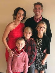 Jay and Jill Holm with their three children, McKenzie, 11, Max, 9 and Madden, 5.