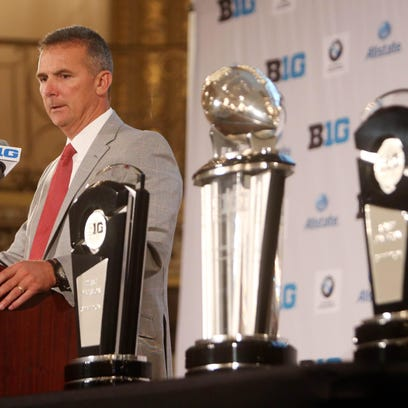 Ohio State coach Urban Meyer addresses reporters during