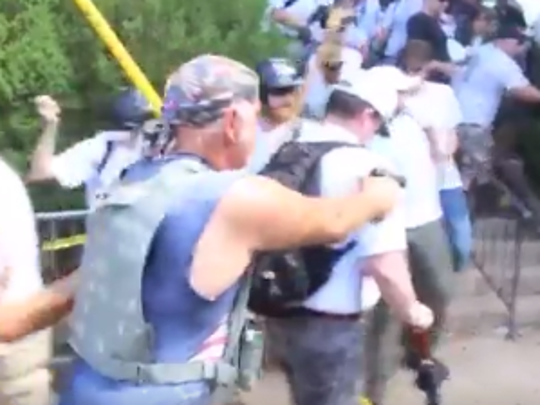 In footage posted by the ACLU of Virginia on its Twitter account, a man appears to point a gun at the crowd during the Charlottesville, Va., rally in August.