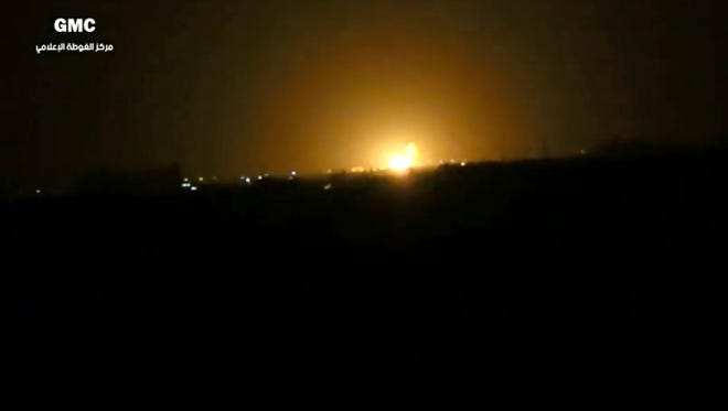 This frame grab from video provided by the Syrian anti-government activist group Ghouta Media Center, which has been authenticated based on its contents and other AP reporting, shows flames rising after an explosion near an airport west of Damascus, Syria, Thursday, April 27, 2017.