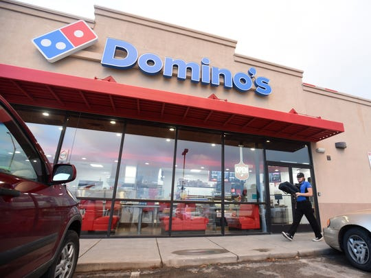 James McGlasson leaves for another delivery from the new Domino's in Bloomfield on Wednesday.
