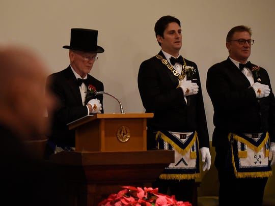 Robert Hall, (left) served as the installing Grand Master for the election of new officers at the Birmingham Masonic Temple.