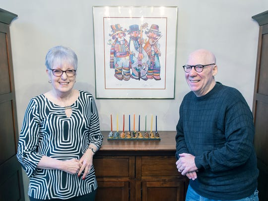 Carol, left, and Bob Grossman pose for a picture in Spring Garden Township with the menorah they purchased in Capetown, South Africa.