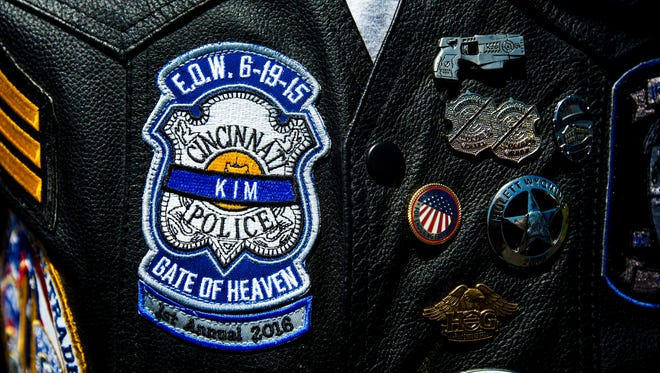Member of the Iron Shields wear a patch on their vests for fallen Cincinnati Police Officer Sonny Kim at the first annual Sonny Kim memorial ride.