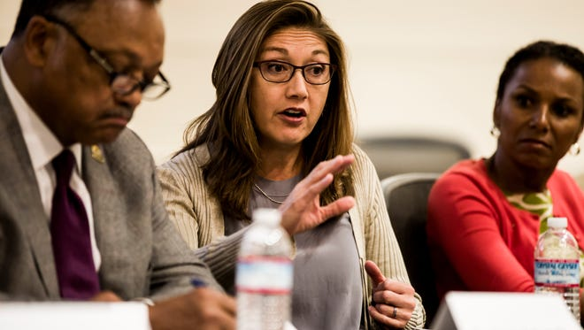 Nancy Lee, center, director of People Operations at Google, speaks at a panel on diversity in tech at Stanford University on Nov. 6, 2014.