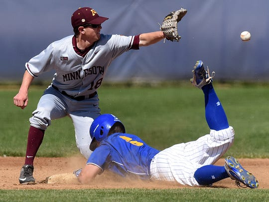 SDSU's Phil Velez slides safely into second base while