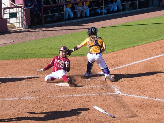 Cassidy Davis (70) slides home for a scored run during Florida State's 13-1 victory over Lipscomb on Friday February 10th.