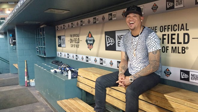 In this photo taken Tuesday, Sept. 1, 2015, Seattle Mariners ace Felix Hernandez smiles as he discusses his style and love of fashion, in the visiting team dugout at Minute Maid Park in Houston. Hernandez has a wardrobe befitting his royal nickname. King Felix dominates on the mound and his fashion rules off of it. The 29-year-old has painstakingly cultivated his style over 11 major league seasons and revels in discussing the intricacies of his look.