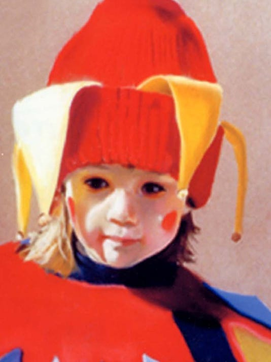 Baby Jester wearing a clown costume