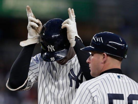 New York Yankees' Didi Gregorius (18) motions to the