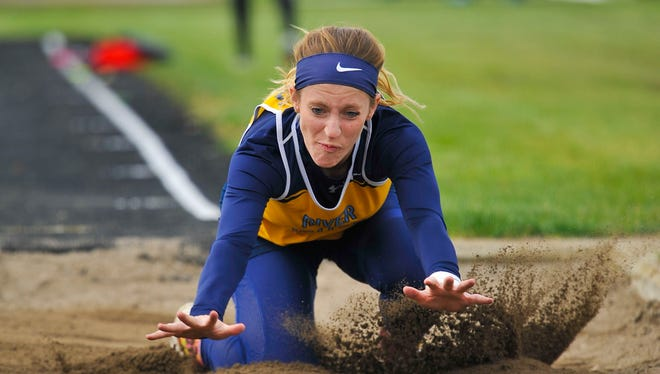 River Valley senior long jumper Anna Hopkins lands in the sand pit during Wednesday's Marion County Track Meet at RV. She won the long jump at 14-8.