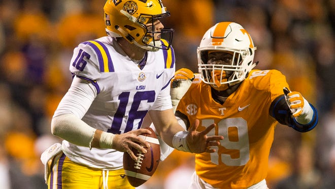 Tennessee defensive lineman Darrell Taylor (19) chases down LSU quarterback Danny Etling (16) during a game between Tennessee and LSU at Neyland Stadium in Knoxville, Tenn., on Saturday, Nov. 18, 2017.