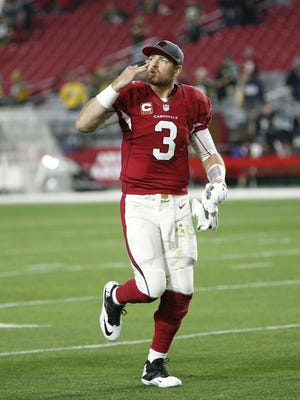 Arizona Cardinals QB Carson Palmer blows a kiss toward the stands after defeating the Green Bay Packers 38-8 in NFL action December 27, 2015 in Glendale, Ariz.