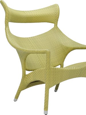 This high-back lounge chair is part of JANUS et Cie's Amari Collection that features JANUSfiber hand woven around a powder-coated aluminum frame.