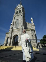Father Joe Coerber stands outside St. John the Baptist