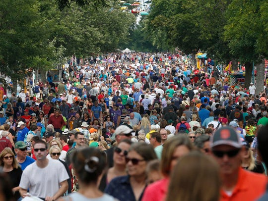 Thousands packed the Minnesota State Fair Friday, Aug.